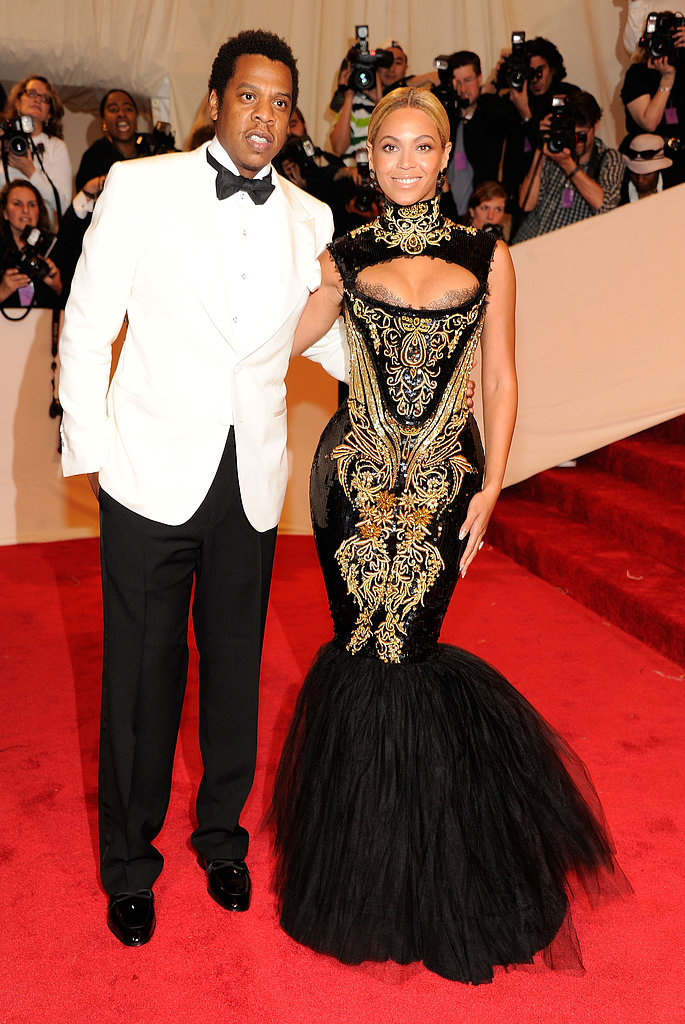 At the 2011 Met Gala in NYC, Beyoncé looked exquisite in a black-and-gold Alexander McQueen gown, while Jay-Z looked sharp in a white tuxedo jacket.