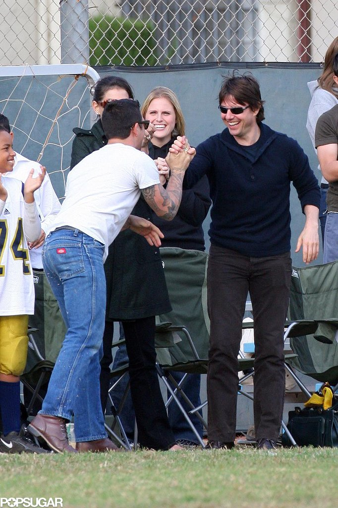 Tom Cruise got a high five from a friend while watching his daughter Isabella playing soccer in Beverly Hills in October 2006.