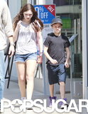Romeo Beckham went shopping with a lady friend in LA.