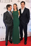Tom Cruise, Olga Kurylenko, and Joseph Kosinski had a laugh on the red carpet.
