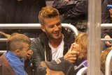 Cruz laughed and watched while David Beckham cleaned up Romeo's face during a November 2009 hockey game in LA.