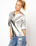 If you're looking for something high-impact (that you can still get away with wearing with your boyfriend jeans), then this ASOS metallic leather t-shirt ($150) is exactly what you need.