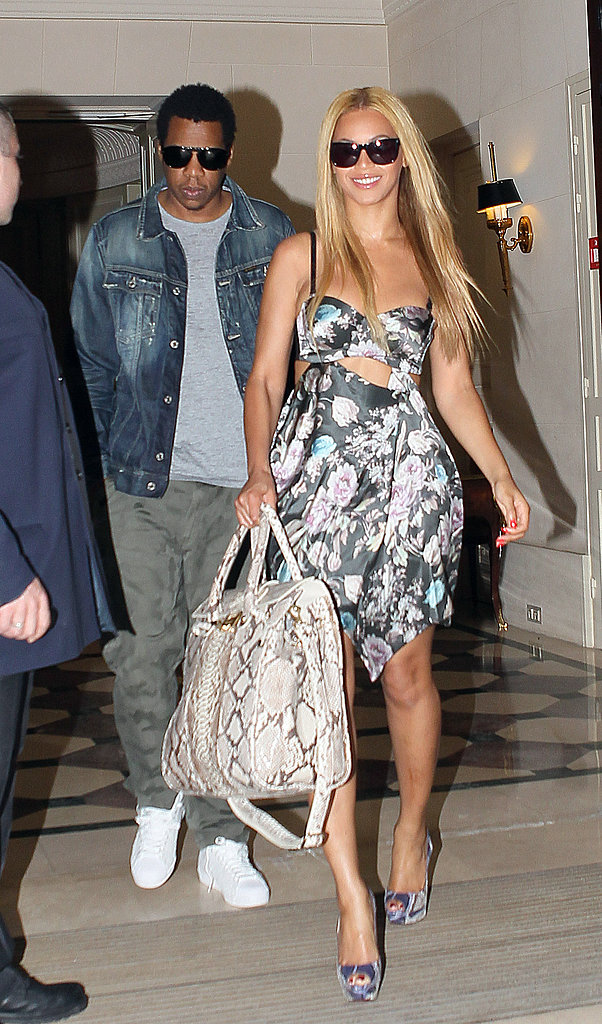 Beyoncé and Jay-Z exited Le Meurice hotel in Paris in 2011, Beyoncé in a flirty floral cutout dress and Jay-Z in a denim jacket and army-green pants.