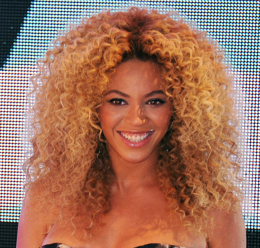 Oversized, voluminous curls are a Beyoncé beauty mainstay, and she wore them well at the one-year anniversary for the East Harlem Target in NYC in 2011.