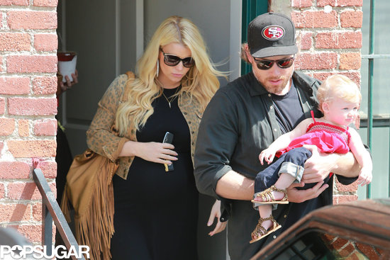 Jessica Simpson left an office with her fiancé, Eric Johnson, and their daughter, Maxwell.