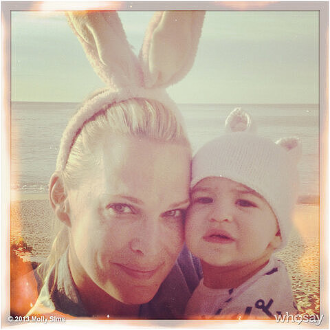 Molly Sims and Brooks Stuber hit the beach with their bunny ears. Source: Twitter user MollyBSims