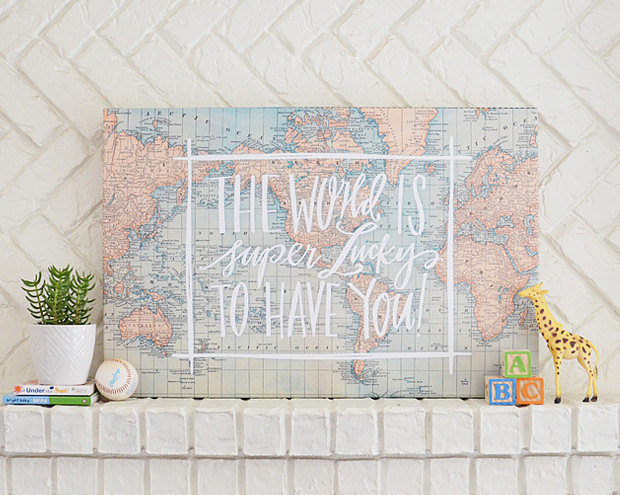 "A vintage map exclaims ""The World Is Super Lucky to Have You!"" on this canvas ($150-$200), available in two sizes."