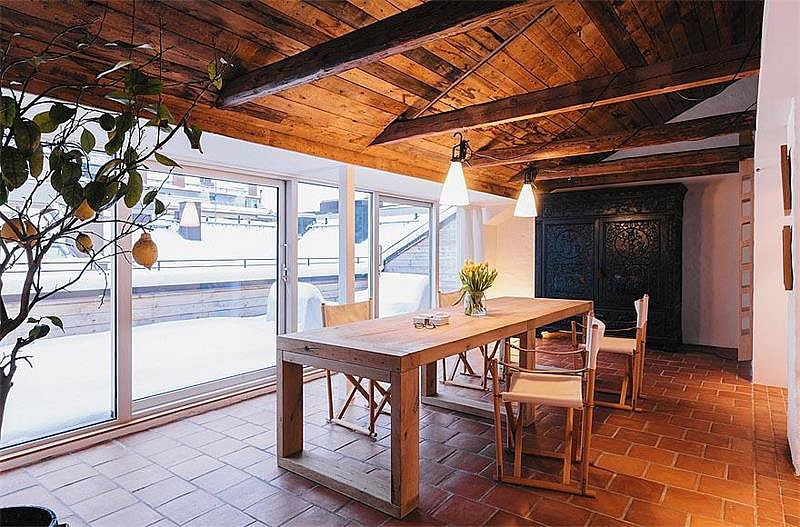 Wooden beams and greenhouse plants give the dining room an earthy vibe. Source: Sotheby's