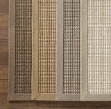Restoration Hardware's Belgian Looped Wool Sisal Rug ($480-$3,595) is made with natural wool and pure linen.