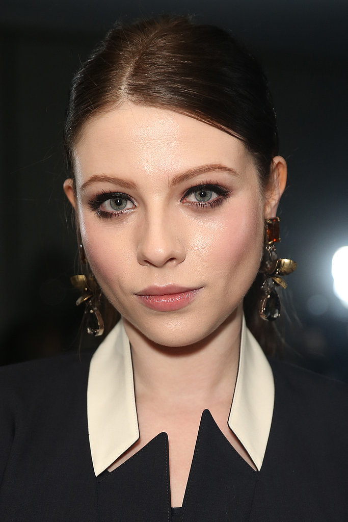 Showing off her sophisticated style, Michelle Trachtenberg opted for slicked-back hair, well-lined eyes, full lashes, and a soft-pink pout.