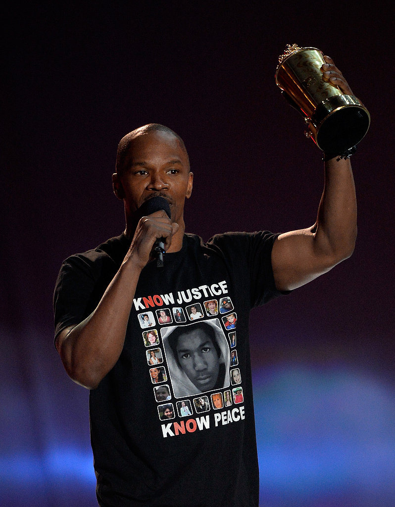 Jamie Foxx raised raised his popcorn award.