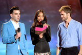 Star Trek Into Darkness stars Zachary Quinto, Zoe Saldana, and Chris Pine gathered together to present an award on stage.