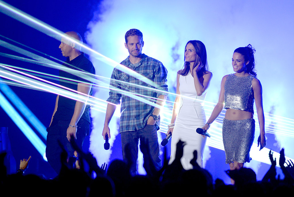 The Fast and the Furious cast members Vin Diesel, Paul Walker, Jordana Brewster, and Michelle Rodriguez made their way to the stage at the show.
