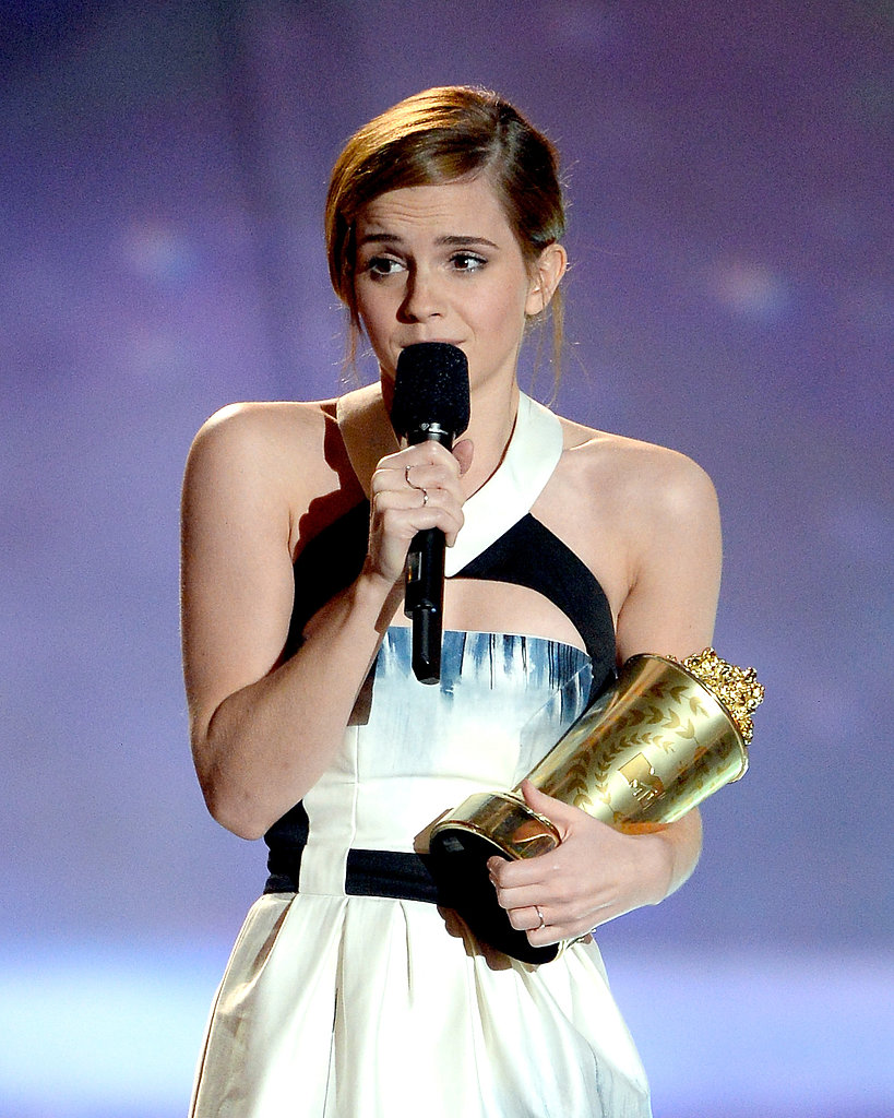 Emma Watson cradled her golden popcorn at the MTV Movie Awards.