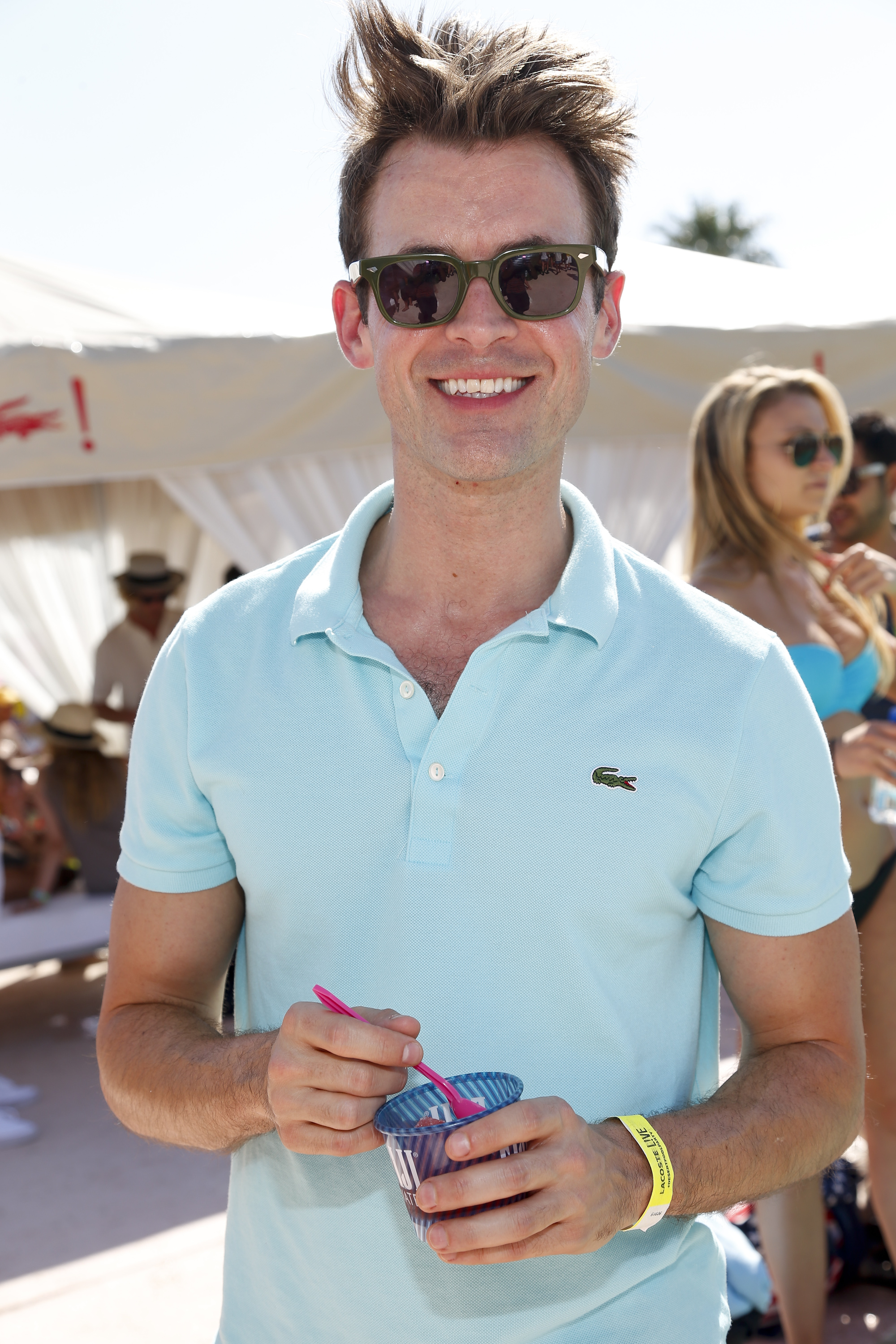 Brad Goreski smiled at the Fiji Water at Lacoste L!ve Coachella Desert Pool Party event in 2013.