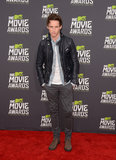 Eddie Redmayne went casual in a leather jacket on the MTV Movie Awards red carpet.