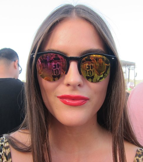 A red lip and tinted sunglasses are a pretty pairing. Photo: Meg Cuna