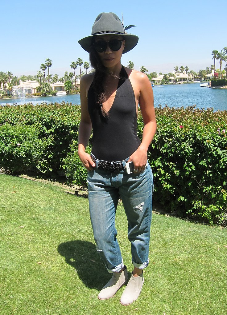 Hugo Boss PR guru Catherine Kim showed off her cool Coachella party style in a pair of boyfriend jeans, black halter bodysuit, and feathered fedora. Source: Meg Cuna
