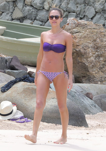 Jessica Alba mismatched a purple bandeau bikini top with printed bottoms in St. Barts.