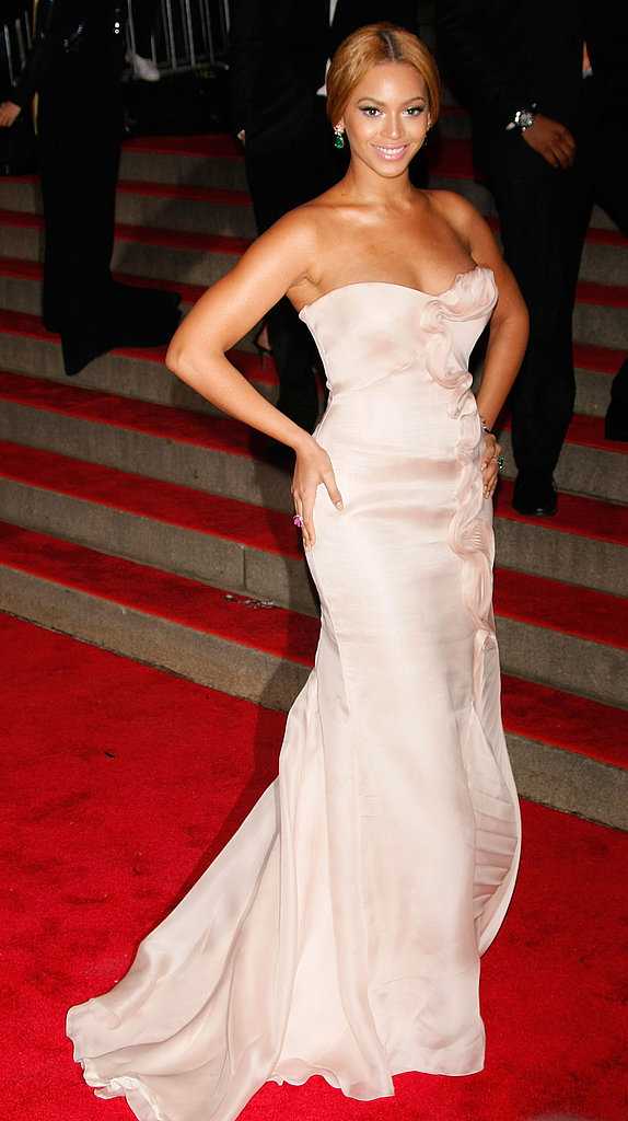 For her first-ever Met Gala in 2008, Beyoncé stepped out in a strapless blush-toned Armani Privé gown. She kept her hair swept back in a low bun, which showed off a pair of subtle, albeit stunning, green earrings.