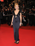 The blond stunner oozed elegance in a midnight-blue satin Chanel gown and jeweled Roger Vivier pumps.