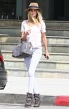 Rosie Huntington-Whiteley is no stranger to a great pair of Isabel Marant boots, and her latest look featured the designer's cool Western-inspired ones. The model styled her boots with geometric-print sknny jeans, a white t-shirt, a gray Saint Laurent tote, and a wide-brimmed fedora.