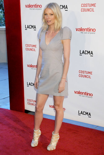 Gwyneth balanced her puff-sleeved minidress with bandaged Christian Louboutin booties at the Valentino: The Last Emperor premiere in LA.