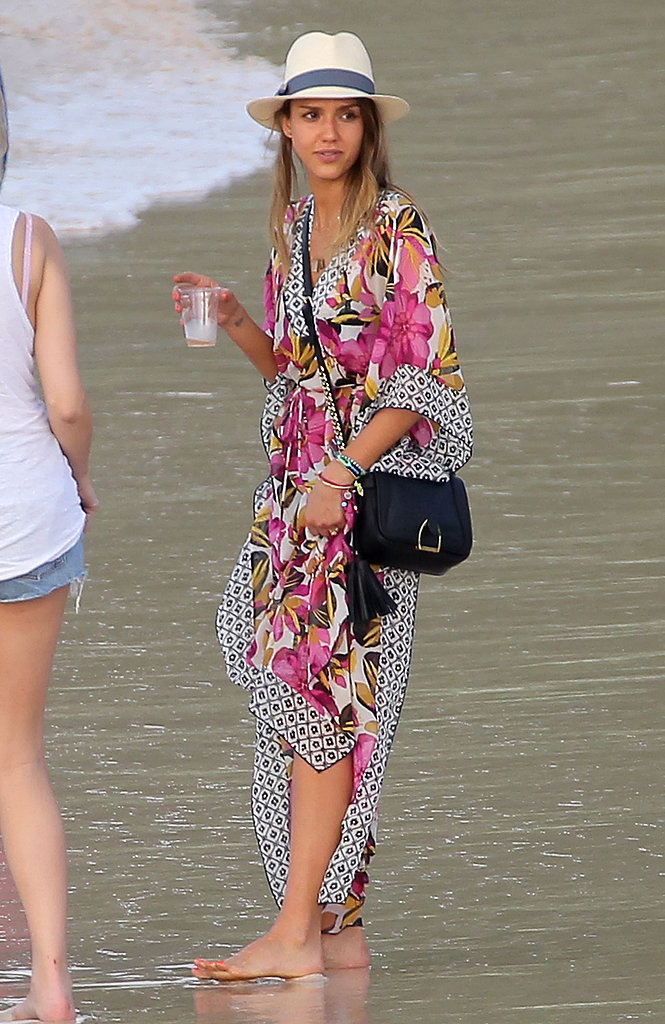 Jessica's floral Tory Burch caftan ($375) and Tory Burch fedora amped up her vacation style.