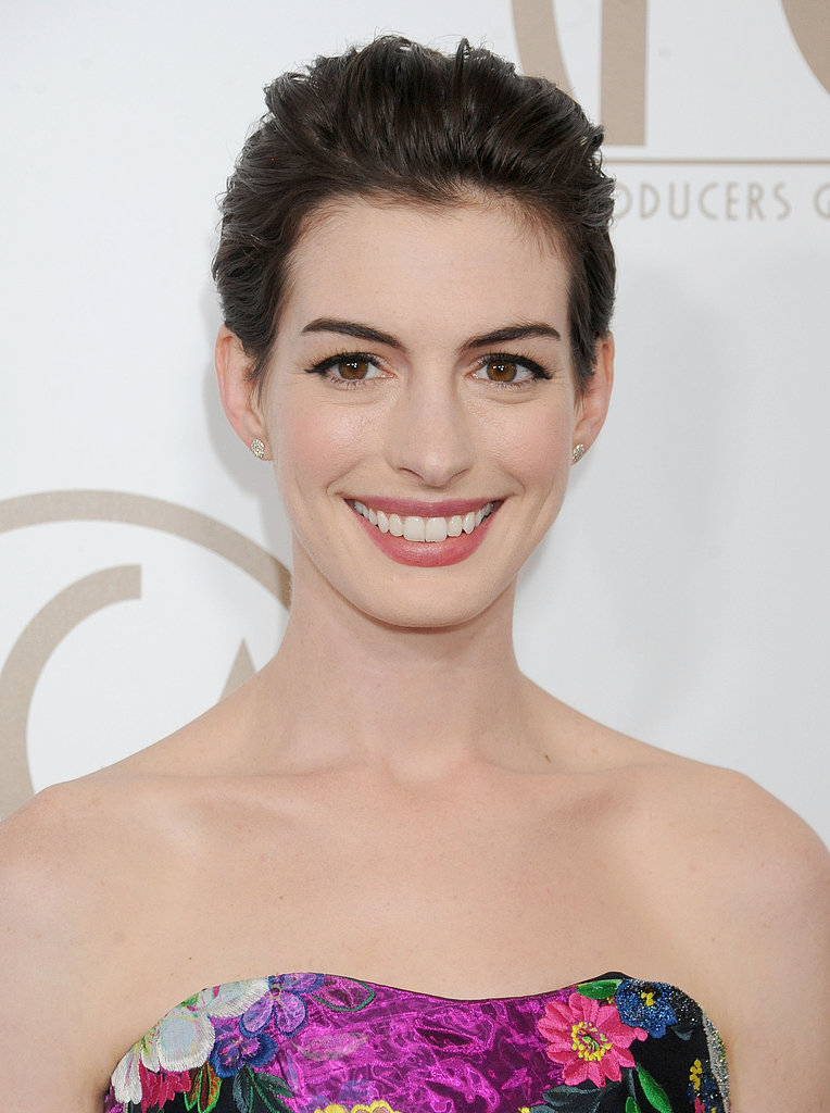 Have a grown-out pixie? Create the illusion of an up 'do by having your hair brushed back like Anne Hathaway.
