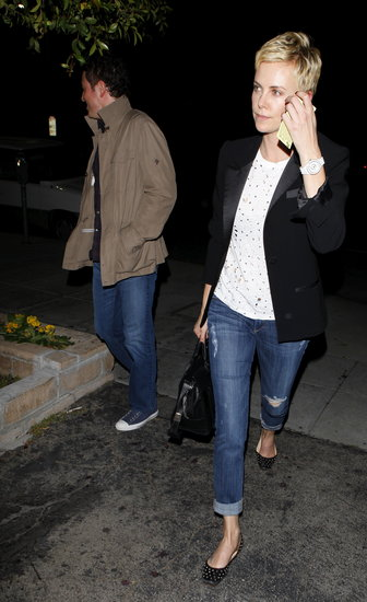 Charlize Theron and Seth MacFarlane walked out of a sushi restaurant together.