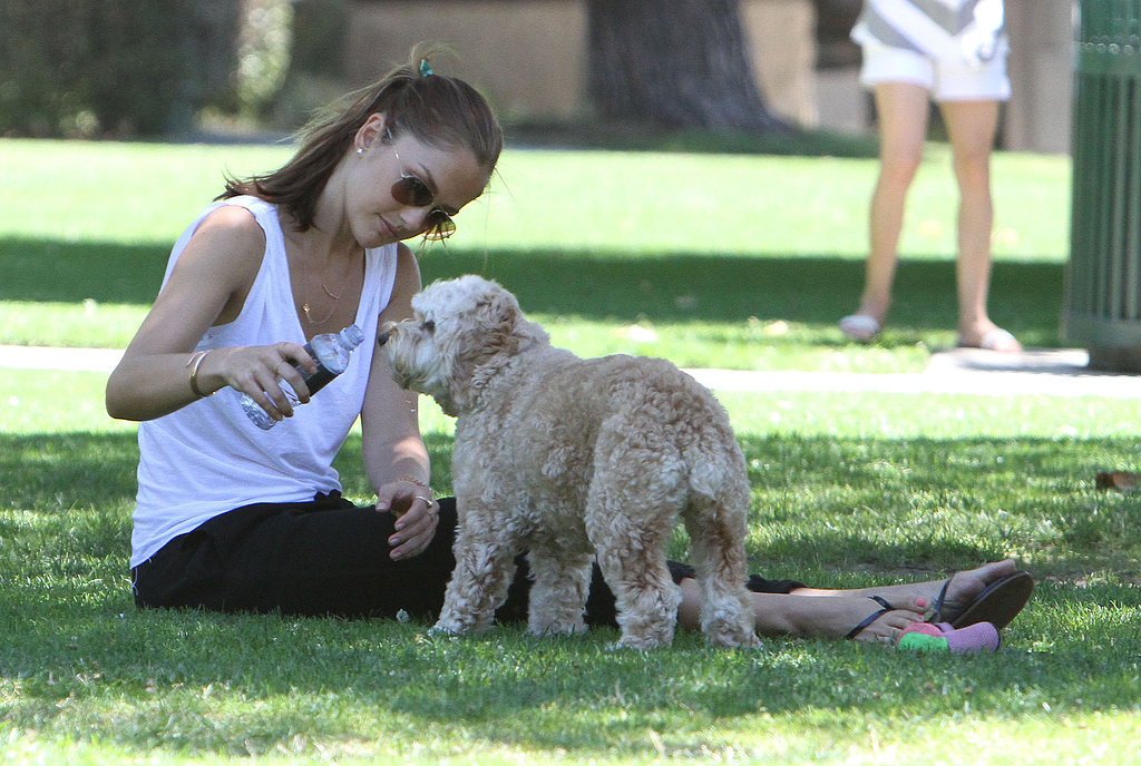 Minka Kelly gave her dog Chewy a few sips while playing at an LA park in July 2012.