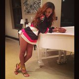 Rihanna struck a sexy pose on a piano. Source: Instagram user badgalriri