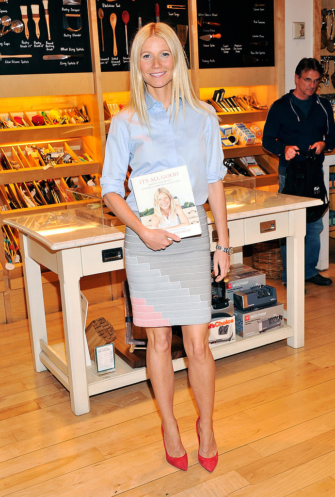 For her Williams-Sonoma book signing in NYC, Gwyneth tucked a crisp button-down into a Band of Outsiders bandage skirt, then slipped on a pair of red-hot Gianvito Rossi pumps for a pop of flair.