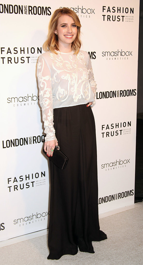 For the fancy occasion, Emma Roberts opted to tuck an intricate white blouse into a black maxi skirt, then completed her two-toned look with a black clutch.