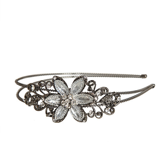 A pretty headband is something that all your bridesmaids will enjoy, and one with delicate stones like WetSeal's Paved Edge Headband ($8) is decidedly decadent.