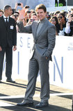 Tom Cruise waved to fans at the Oblivion premiere in Hollywood.