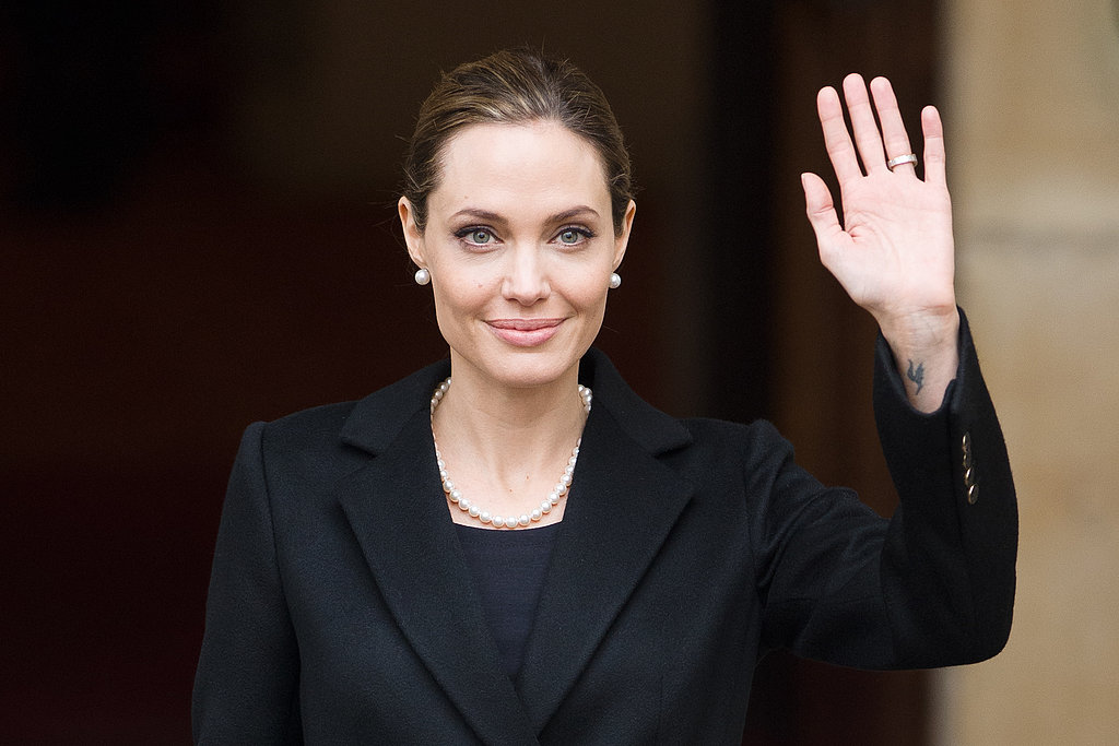 Angelina Jolie waved while in London for the G8 Foreign Ministers' conference.