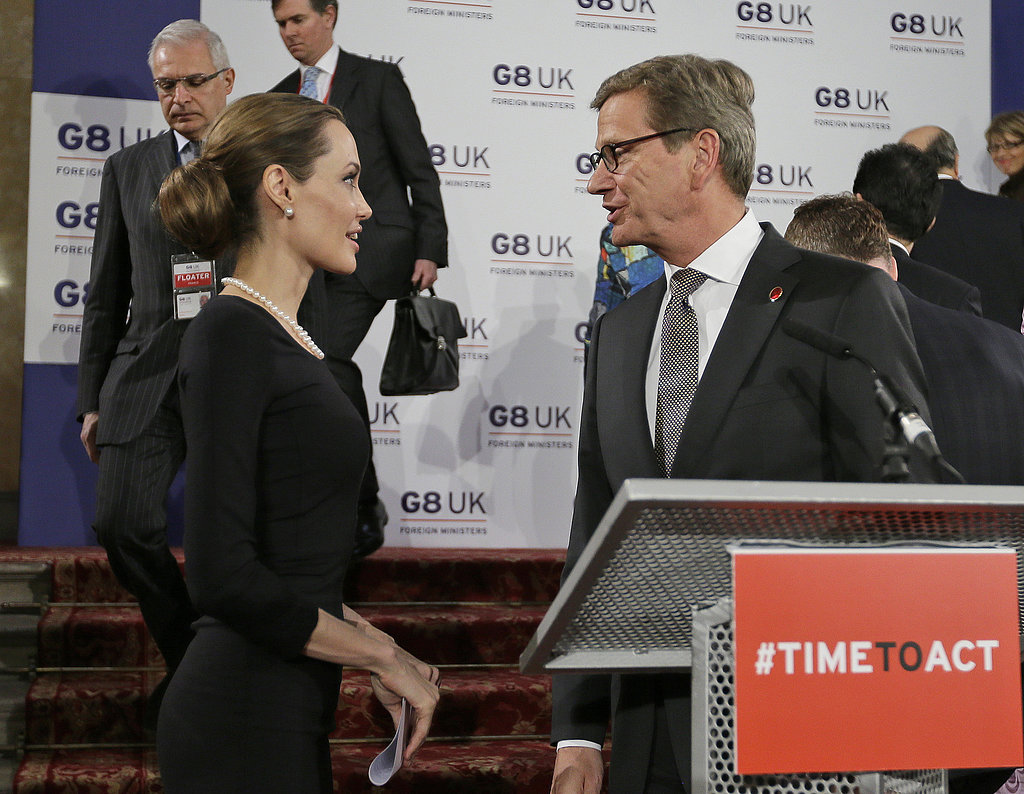 Angelina Jolie and Guido Westerwelle of Germany exchanged words at the G8 Foreign Ministers' conference in London.