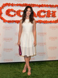 Abigail Spencer looked fresh in a white DKNY leather dress and peach-colored heels. Her pink Coach leather flap clutch provided a cool burst of color.