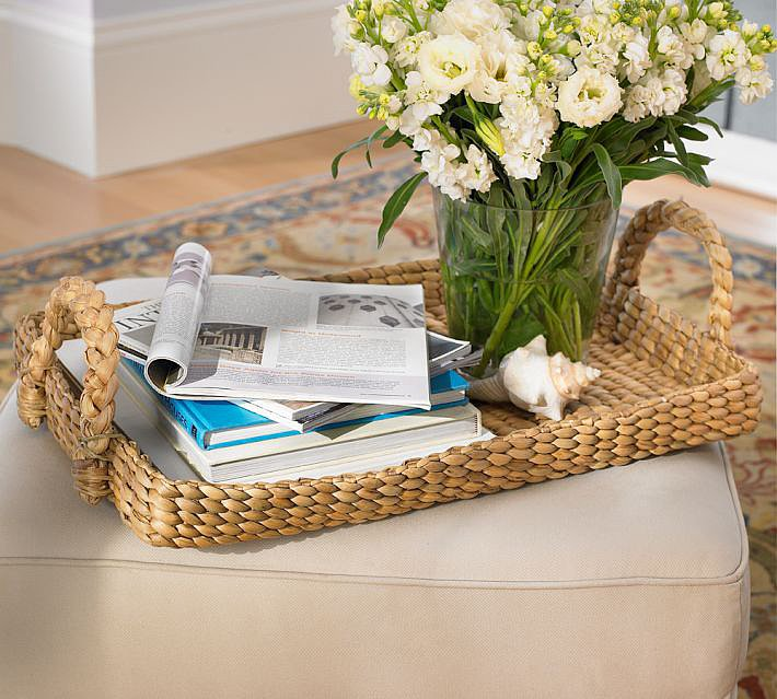 Keep your coffee table styled yet relaxed using this straw tray ($39).