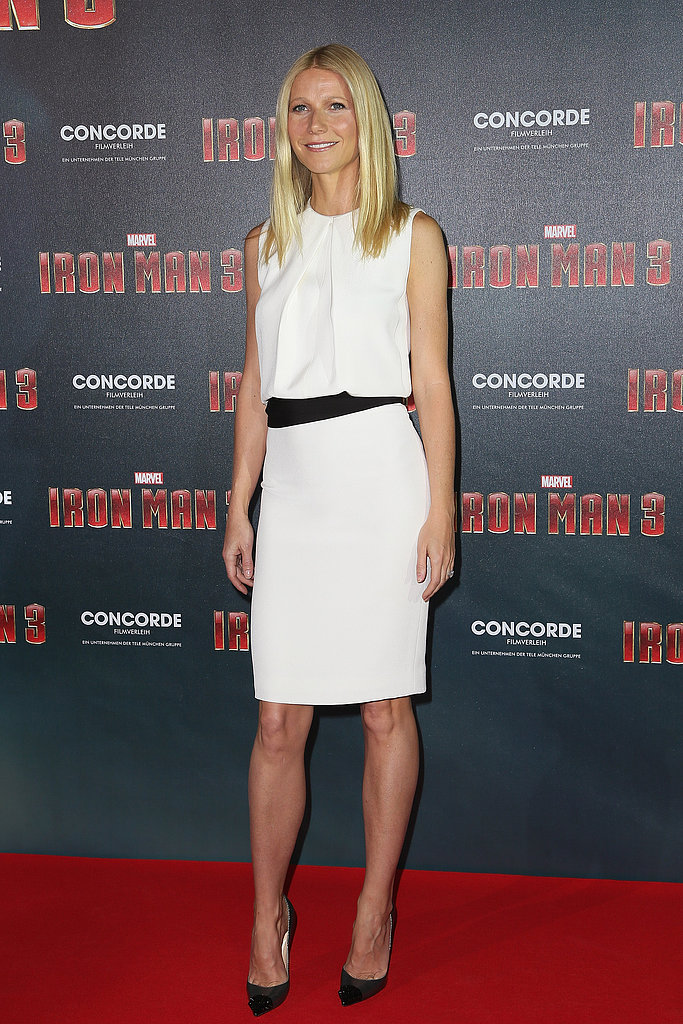 Gwyneth Paltrow stepped out for the Iron Man 3 photocall in Munich in a crisp white pleated-front KaufmanFranco dress, which she then accented with a black waist belt, also by the designer.