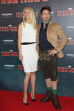 Gwyneth Paltrow posed alongside her Iron Man 3 costar Robert Downey Jr. in a sleeveless LWD by KaufmanFranco and pointy-toe pumps by Christian Louboutin.