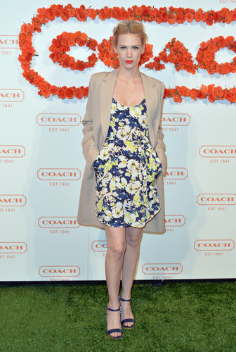 At a Coach party in LA, January Jones paired a blue-and-yellow floral dress with a camel coat and Coach's Terri woven-heel sandals.