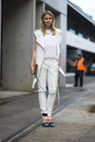 All-white everything got an edgier feel with a moto-style vest. Source: Le 21ème | Adam Katz Sinding