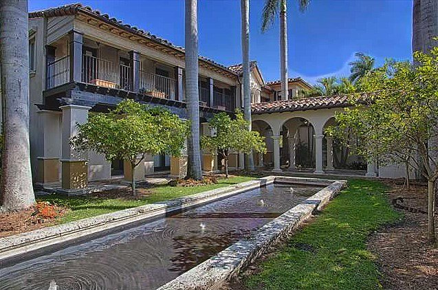 A view of the Spanish-style architecture showcases the home's courtyard and fountain.  Source: Coldwell Banker Real Estate