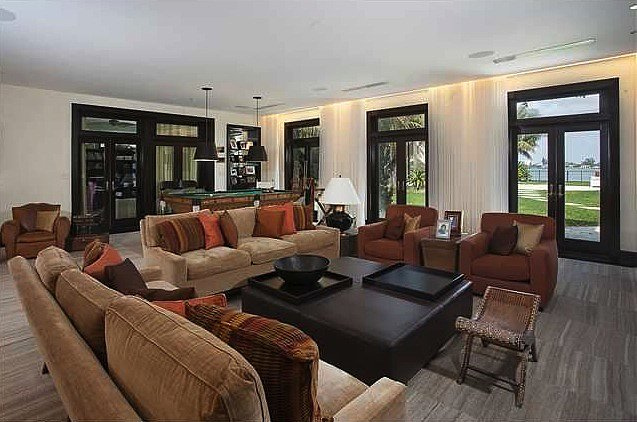 A grand family room — complete with ocean views — has enough space for a pool table!   Source: Coldwell Banker Real Estate