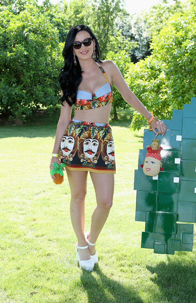 Katy Perry showed how to work playful and sexy in a printed bustier halter top and a miniskirt, both by Dolce & Gabbana, at the Lacoste pool party at Coachella.