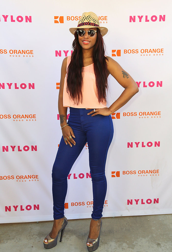 Singer Eve donned a pair of blue skinny jeans with a peach tank and metallic peep-toes at the Nylon house party. A straw hat and round sunglasses protected her from the sun's rays.