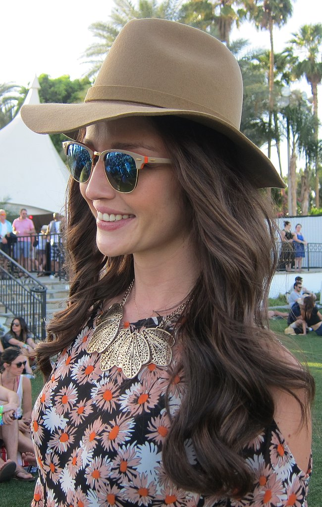 Matching your hair to your hat and sunglasses makes for a chic effect.
