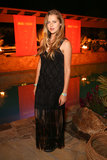 Teresa Palmer looked effortless and edgy in her black maxi dress and Aldo boots at the Diesel + Edun event.